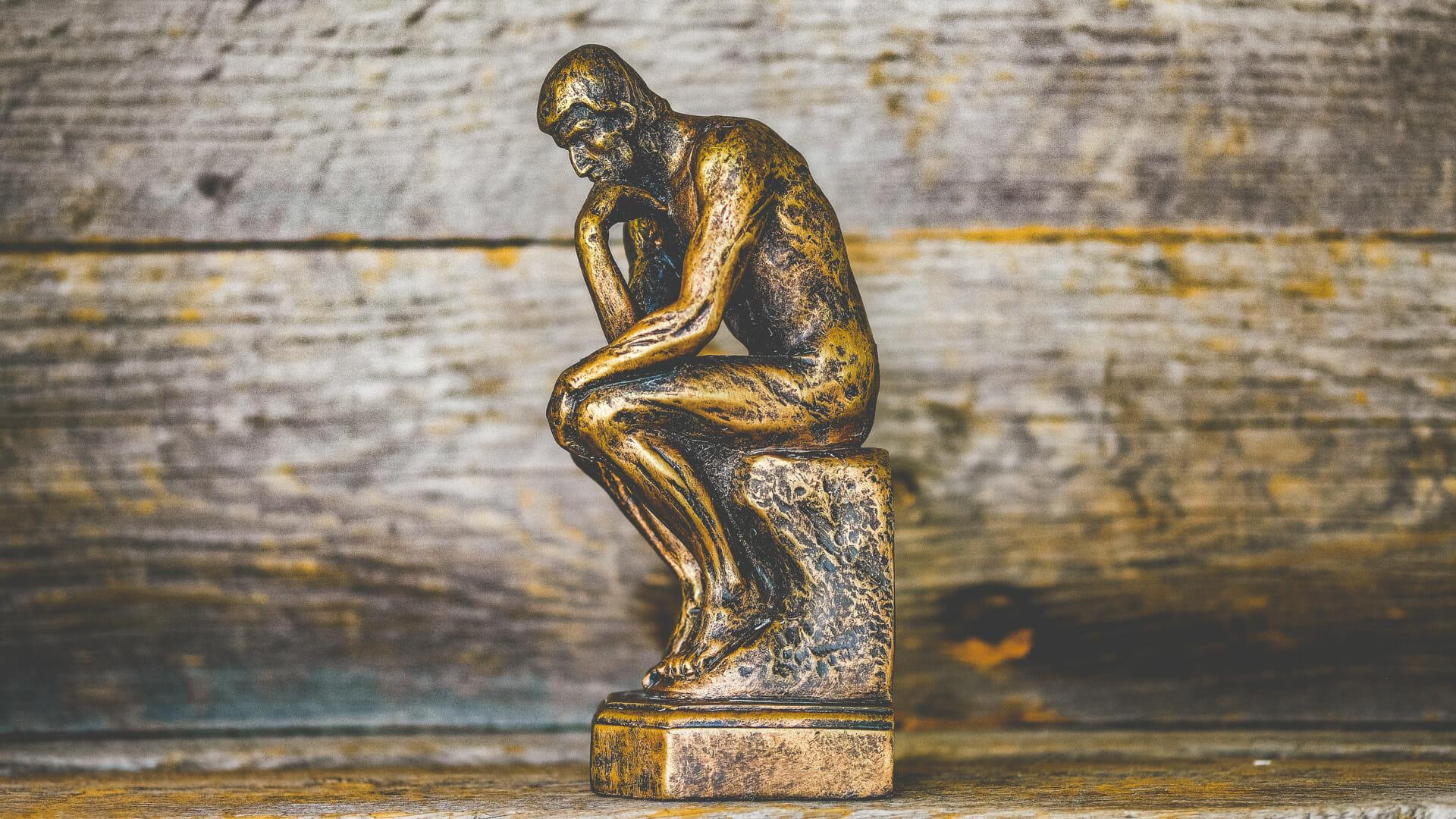 pondering statue